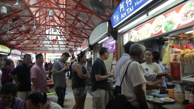 customers wait in line for food at maxwell market in singapore on monday 5 august a customer eats a plate of food at a table in food hall a woman... - lunch break stock videos & royalty-free footage