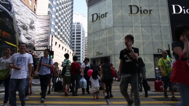 customers wait in line to enter an hermes store operated by hermes international sca in the tsim sha tsui area of hong kong china on tuesday oct 1... - hermes designer label stock videos and b-roll footage