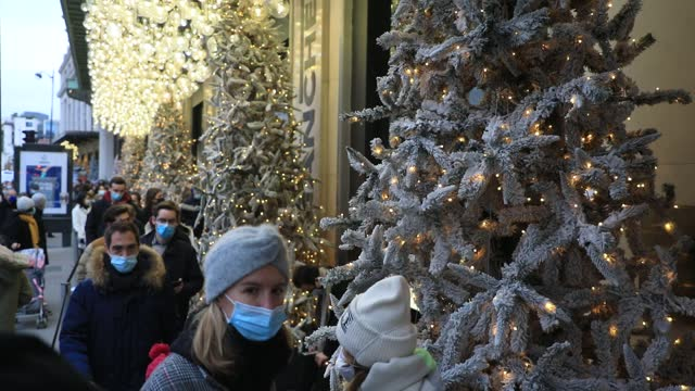 customers wait to enter the prestigious 'bon marche' department stores during the period of christmas shopping and black friday postponed in france... - gourmet stock videos & royalty-free footage