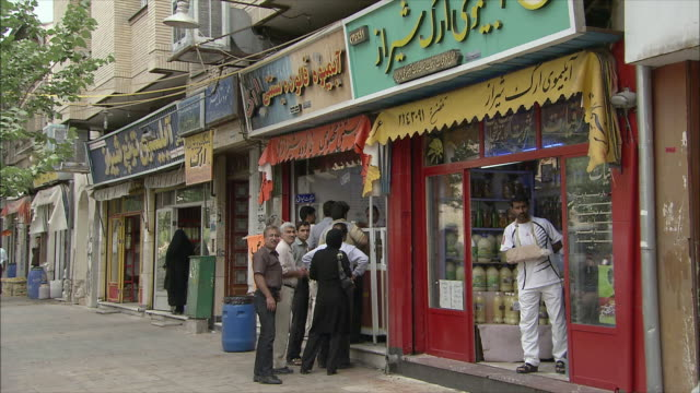 ws customers waiting in line outside store, shiraz, iran - イラン点の映像素材/bロール