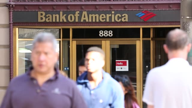 customers walk by a bank of america corp atms outside of a branch in los angeles california us on monday july 13 2015 shots wide shots of bank of... - bank of america stock videos & royalty-free footage