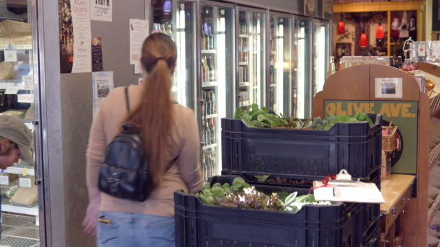 customers walk by grocery store display coolers stocked with sandwiches salads and bottled drinks r/f to crates of fresh lettuce / redlands, california, usa - water cooler stock videos & royalty-free footage