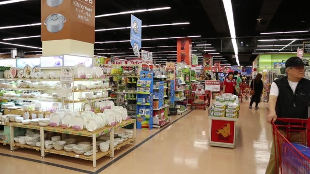 customers walk past an entrance of a lotte shopping co lotte mart inside the lotte mall gimpo airport in seoul customers push shopping carts through... - kitchenware department stock videos and b-roll footage