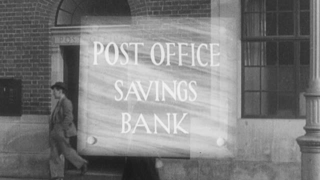1938 montage customers walking into the local bank and sitting on a park bench in the green / leominster, england, united kingdom - leominster stock videos and b-roll footage