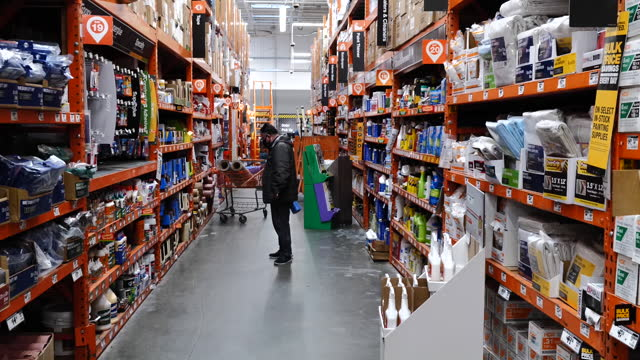 customers with shopping carts shopping at home depot in pleasanton, california, u.s., on monday, february 22, 2021. - catena di negozi video stock e b–roll