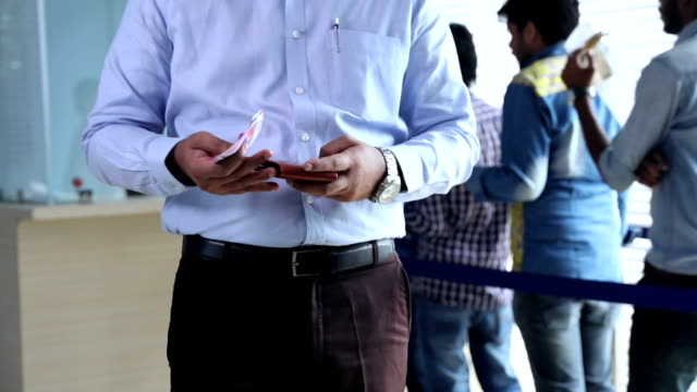 customers withdraw indian two thousand banknotes from bank, delhi, india - banking stock videos & royalty-free footage