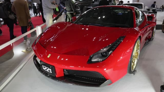 A customized Ferrari automobile stands on display at the Tokyo Auto Salon in Chiba Japan on Friday Jan 12 Close up a customized hub cap is seen on a...