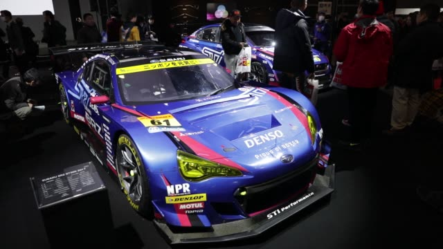 Customized Subaru BRZ GT 300 vehicles stand on display at the Tokyo Auto Salon in Chiba Japan on Friday Jan 12 Attendees look at a Subaru BRZ GT 300...
