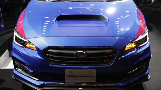 A customized Subaru WRX STI S208 vehicle stands on display at the Tokyo Auto Salon in Chiba Japan on Friday Jan 12 Attendees inspect a customized...
