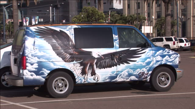 A customized van parks in a downtown San Diego parking lot.