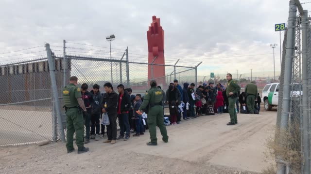 customs and border patrol agents talk to central american immigrants at the u.s.-mexico border fence on february 01, 2019 in el paso, texas. the... - geographical border stock videos & royalty-free footage