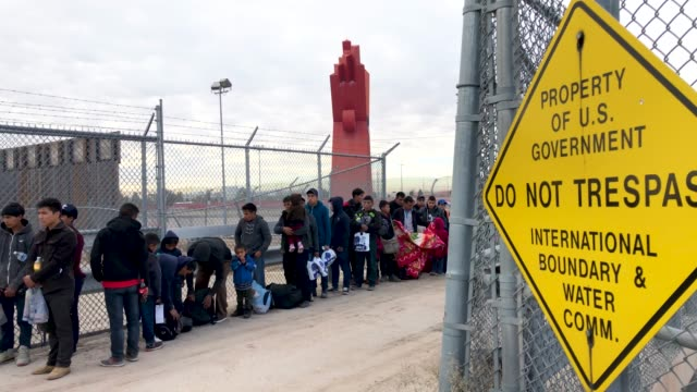 us customs and border patrol agents talk to central american immigrants at the usmexico border fence on february 01 2019 in el paso texas the... - international border barrier stock videos & royalty-free footage