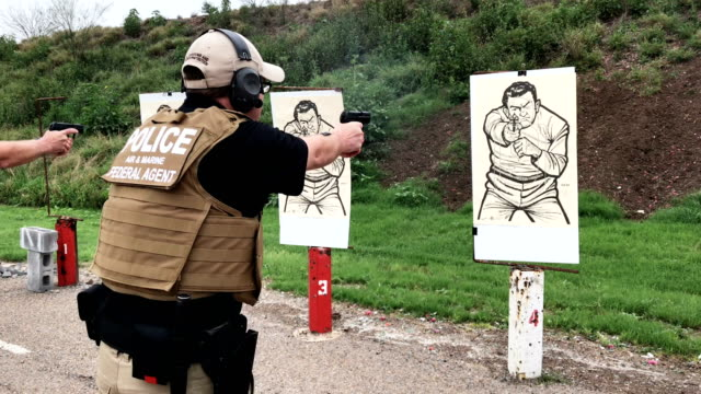 us customs and border protection agents shoot during a a firearms qualification test at a shooting range on february 22 2018 in hidalgo texas cbp... - target shooting stock videos & royalty-free footage