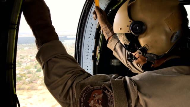 customs and border protection black hawk helicopter flies along the u.s.-mexico border on february 21, 2018 near mcallen, texas. federal border... - 国境点の映像素材/bロール