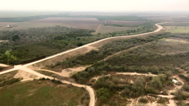 customs and border protection black hawk helicopter flies along the u.s.-mexico border on february 21, 2018 near mcallen, texas. federal border... - mcallen texas stock videos & royalty-free footage