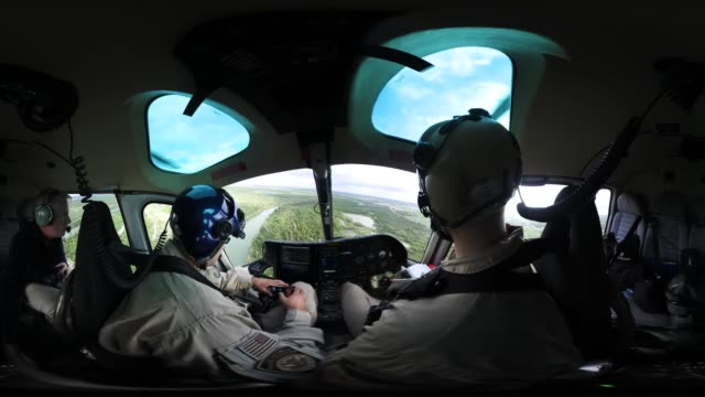'A US Customs and Border Protection helicopter pilot searches for undocumented immigrants while flying a patrol over the USMexico border on March 15...