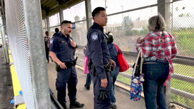 customs and border protection officer speak to an asylum seeker at the international bridge from mexico to the united states on december 09, 2019... - mexican american stock videos & royalty-free footage