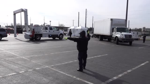 customs and border protection officers from the office of field operations inspect and x-ray all vehicles prior to allowing them entry into... - guarding stock videos & royalty-free footage