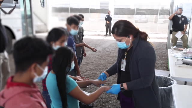 customs and border protection personnel process immigrants at a temporary facility in donna texas. the temporary facility has been constructed while... - mcallen texas stock videos & royalty-free footage