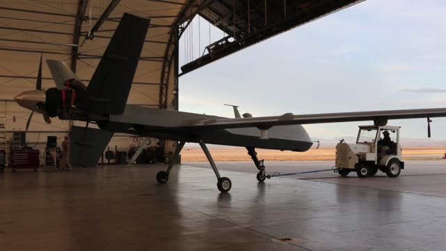 a us customs and border protection predator drone is prepared for takeoff at the flight operations center at fort huachuca in sierra vista arizona... - offizier stock-videos und b-roll-filmmaterial