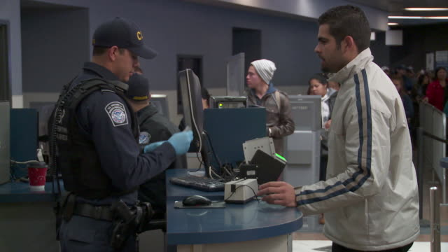 / customs & border protection officer checking documents of people entering us - coast guard stock videos & royalty-free footage
