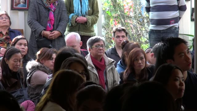 cut away of congregation listening to british abbot ajahn khemadhammo at a buddhist ceremony to mark the last day of vassa at the forest hermitage in... - theravada stock videos & royalty-free footage