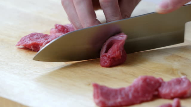cut beef meat - cooking utensil stock videos & royalty-free footage
