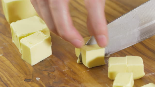 cut butter  into cubes at kitchen - butter stock videos & royalty-free footage