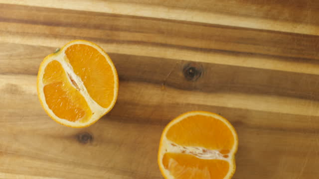 cut fresh orange half - cross section stock videos & royalty-free footage