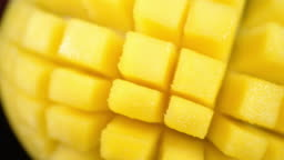 Cut into cubes mango slowly rotates.