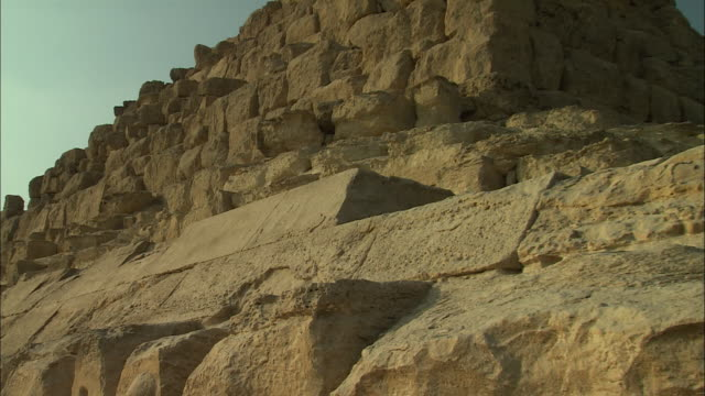 cut stone blocks comprise a pyramid in egypt. - block shape stock videos & royalty-free footage