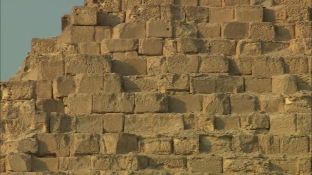 cut stone blocks comprise a pyramid in giza, egypt. - brick stock videos & royalty-free footage