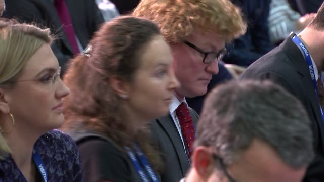 cutaways of george osborne and christine lagarde imf press conference george osborne listening in audience / journalists in audience including jon... - jon snow journalist stock-videos und b-roll-filmmaterial
