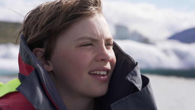 cute 10 years old boy enjoys a rubber boat trip on fjallsárlón glacier lake in iceland - 10 11 years stock videos & royalty-free footage