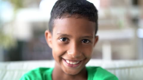 cute afro boy looking at camera - child stock videos & royalty-free footage