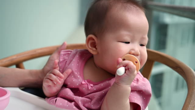 cute asian baby brushing her own teeth - toothbrush stock videos & royalty-free footage