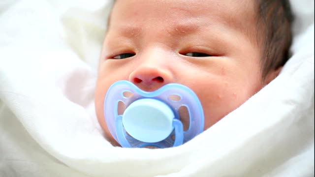 cute asian baby with pacifier - pacifier stock videos and b-roll footage