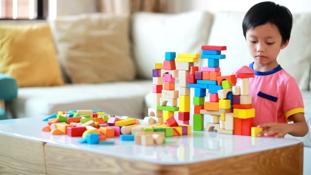 cute asian children playing with blocks - toy block stock videos and b-roll footage