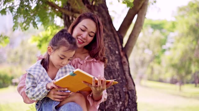 cute asian girl and mother drawing at national green park. - natural parkland stock videos & royalty-free footage
