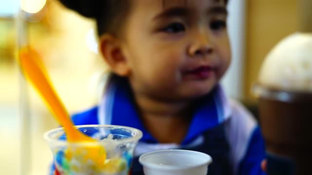 Cute Asian Girl Eating Ice Cream