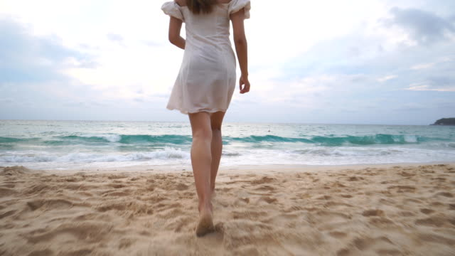 a cute asian girl on the beach in cloudy day - phuket stock videos & royalty-free footage