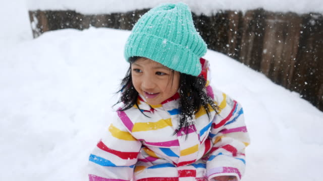 cute asian girl playing snow - hat stock videos & royalty-free footage