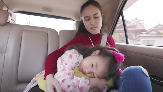 cute asian little girl with her sister at the back of the car seat - sister stock videos & royalty-free footage