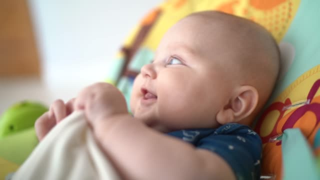 cute baby boy at chair - babyhood stock videos & royalty-free footage