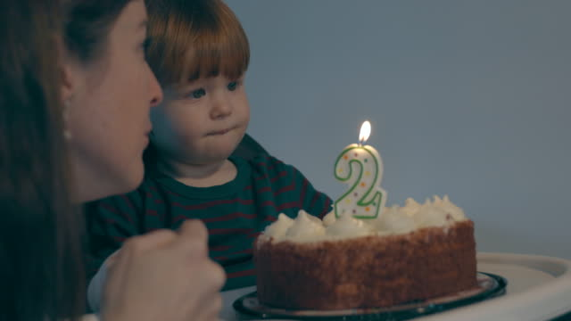 cute baby boy blowing out candles on birthday cake with mom - number 2 stock videos & royalty-free footage