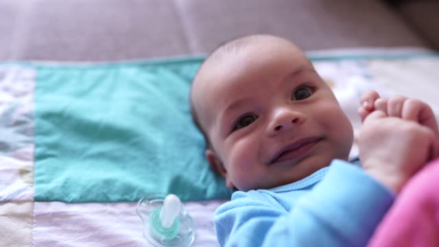 cute baby boy lying on bed - cute stock videos & royalty-free footage