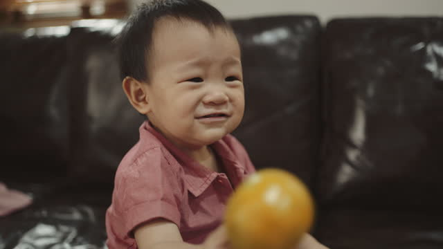 cute baby boy playing toy in living room - youth organisation stock videos & royalty-free footage