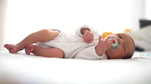cute baby boy sleeping in the morning - lying on side stock videos & royalty-free footage