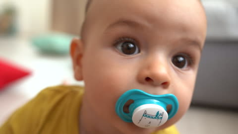 cute baby boy trying to reach camera - babies only stock videos & royalty-free footage