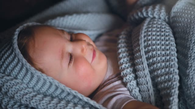 cute baby boy waking up - baby blanket stock videos and b-roll footage